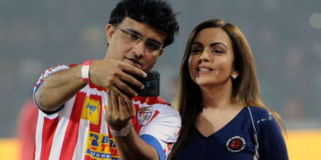 Former cricketer Sourav Ganguly clicks a selfie with Nita Ambani in Kolkata in 2015. (Photo by Prateek Choudhury/Hindustan Times via Getty Images)