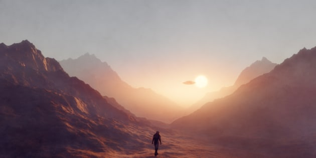 Astronaut walking on Mars, UFO flying.