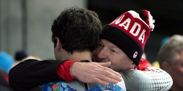 Canada's Sam Edney (left) is consoled following his team's fourth-lace finish in the Luge Team Relay at the Sochi Winter Olympics in Krasnaya Polyana, Russia, Thursday, Feb. 13, 2014.