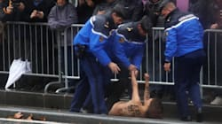 Topless Protester Gets Within Feet Of Trump's Motorcade In