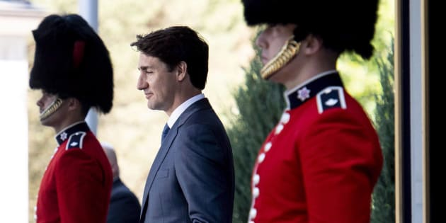 Prime Minister Justin Trudeau passes members of the Ceremonial Guard as he arrives for a press conference following a swearing in ceremony at Rideau Hall in Ottawa on July 18, 2018.