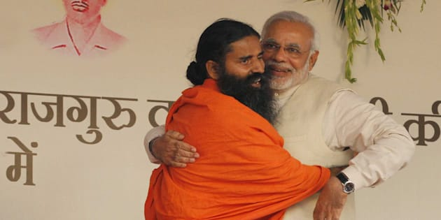 NEW DELHI, INDIA - MARCH 23: BJP prime ministerial candidate Narendra Modi and yoga guru Baba Ramdev during a 'Yoga Mahotsav' at Ramlila Maidan on March 23, 2014 in New Delhi, India.