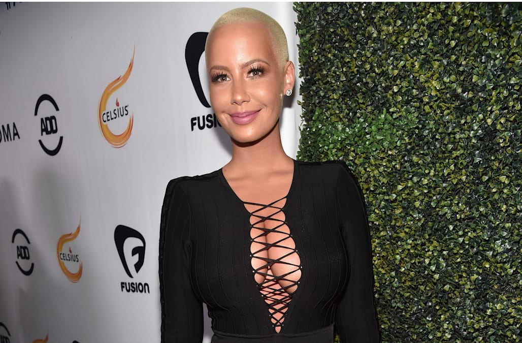 619c0af2c0 Amber Rose is loving her new body! The 34-year-old model and TV personality  got a breast reduction surgery earlier this month and on Sunday she took to  ...
