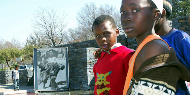 Children visit the Hector Peterson memorial in Soweto.