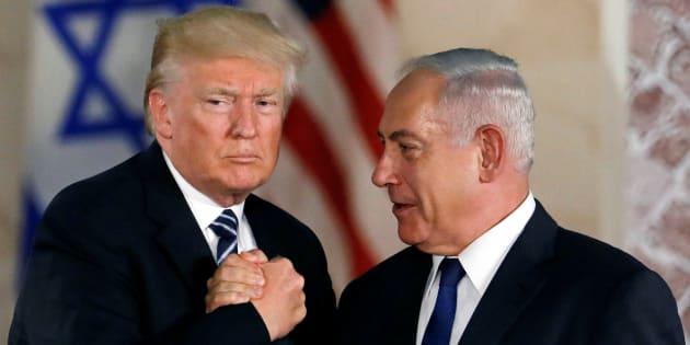 U.S. President Donald Trump and Israeli Prime Minister Benjamin Netanyahu shake hands after Trump's address at the Israel Museum in Jerusalem May 23, 2017. REUTERS/Ronen Zvulun