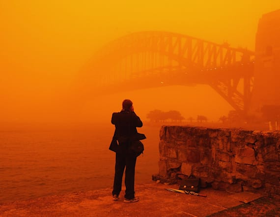 Wild dust storm paints Australian town bright orange