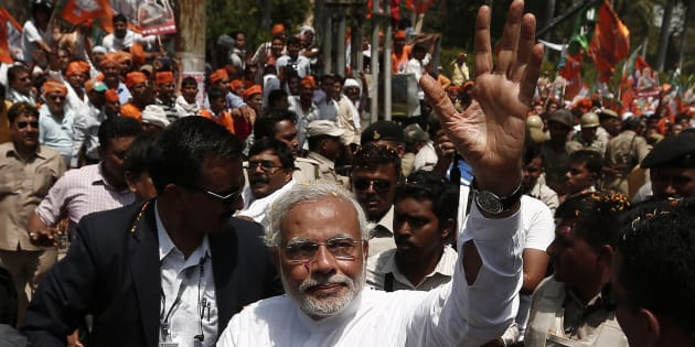 File photo of Narendra Modi, waving to his supporters as he arrives to file his nomination papers for the general elections in the northern Indian city of Varanasi April 24, 2014.