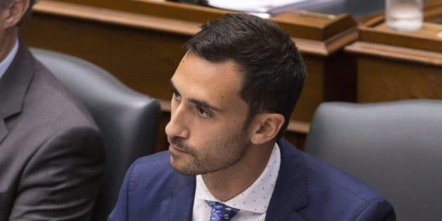 Progressive Conservative MPP Stephen Lecce, right, attends question period at the Ontario legislature in Toronto on July 31, 2018.