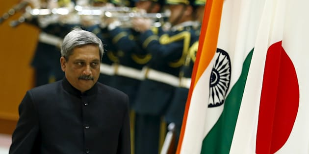 Indian Defense Minister Manohar Parrikar walks past the Indian and Japanese flags as he inspects the honour guard before talks with his Japanese counterpart Gen Nakatani (not pictured) at the defense ministry in Tokyo.