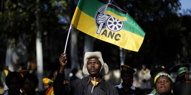 An ANC supporter holds the party's flag.