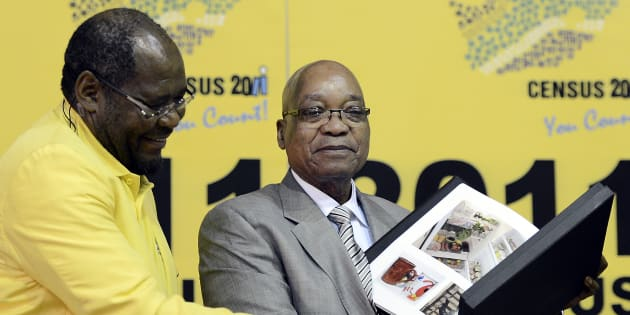 Statistician-General Pali Lehohla (L) poses with President Jacob Zuma. Photo credit should read STEPHANE DE SAKUTIN/AFP/Getty Images