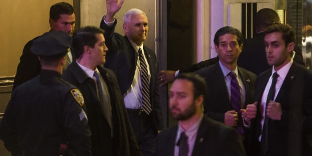 "Vice President-elect Mike Pence, top center, leaves the Richard Rodgers Theatre after a performance of ""Hamilton,"" in New York."
