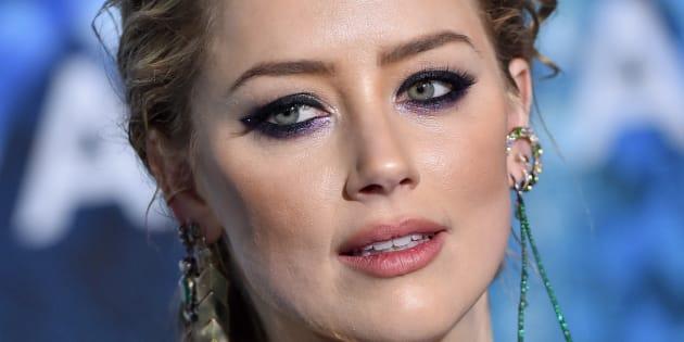 """Amber Heard, actuellement à l'affiche du film """"Aquaman"""" s'est servi de son exemple personnel pour montrer les différentes formes de violence dont les femmes sont victimes chaque jour."""