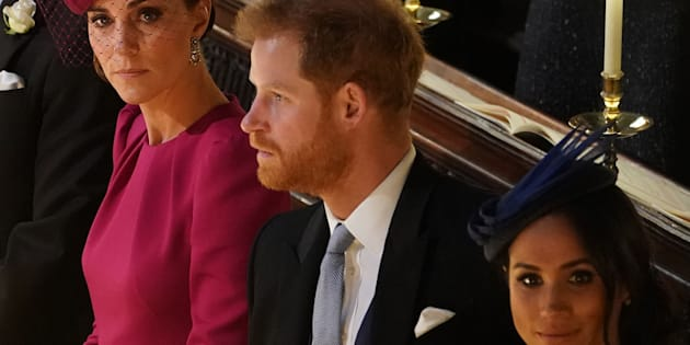 Britain's Catherine, Duchess of Cambridge, Prince Harry, Duke of Sussex, and Meghan, Duchess of Sussex at the wedding ceremony of Britain's Princess Eugenie of York to Jack Brooksbank at St George's Chapel, Windsor Castle, in Windsor, on Friday.