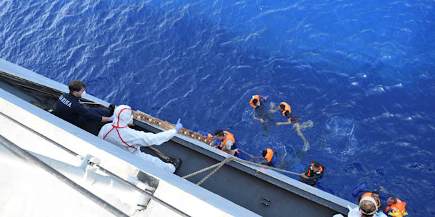 "Migrants from a capsized boat are rescued during a rescue operation by Italian navy ships ""Bettica"" and ""Bergamini"" off the coast of Libya in this handout picture released by the Italian Marina Militare on May 25, 2016. Marina Militare/Handout via REUTERS    ATTENTION EDITORS - THIS PICTURE WAS PROVIDED BY A THIRD PARTY. FOR EDITORIAL USE ONLY.       TPX IMAGES OF THE DAY"