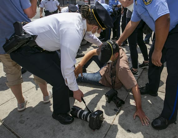 Man charged in attack against AP photographer