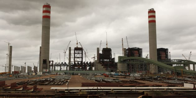 "A general view of the construction site at the Medupi power station in Lephalele April 11, 2013. South African power utility Eskom said on Thursday it will do its utmost to have its new Medupi power plant generate electricity by the end of this year and ease pressure on the national grid, but admitted it will be a ""huge challenge"". Construction was suspended for several weeks earlier this year because of a violent strike and labour protests. REUTERS/Siphiwe Sibeko (SOUTH AFRICA - Tags: ENERGY BUSINESS CONSTRUCTION)"