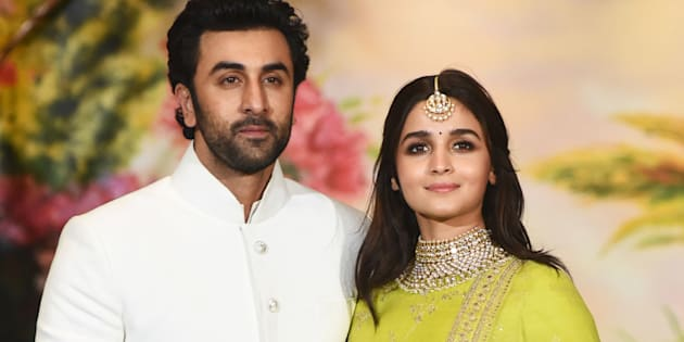 Indian Bollywood actors Ranbir Kapoor (L) and Alia Bhatt pose for a picture during the wedding reception of actress Sonam Kapoor and businessman Anand Ahuja in Mumbai late on May 8, 2018. (Photo by Sujit Jaiswal / AFP)        (Photo credit should read SUJIT JAISWAL/AFP/Getty Images)