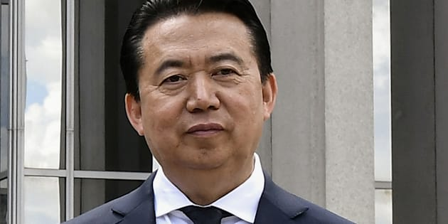 INTERPOL President Meng Hongwei poses during a visit to the headquarters of International Police Organisation in Lyon, France, May 8, 2018.