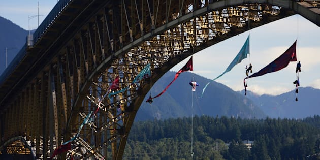 Activists set up to form an aerial bridge blockade in the path of Trans Mountain oil tanker traffic on July 3, 2018. The activists suspended from the Ironworkers Memorial Bridge in Vancouver.