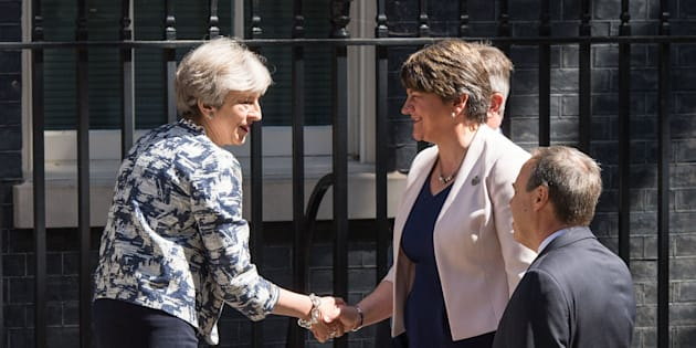 Prime Minister Theresa May greets DUP leader Arlene Foster, DUP deputy leader Nigel Dodds and DUP MP Sir Jeffrey Donaldson outside 10 Downing Street in London ahead of talks aimed at finalising a deal to prop up the minority Conservative Government.