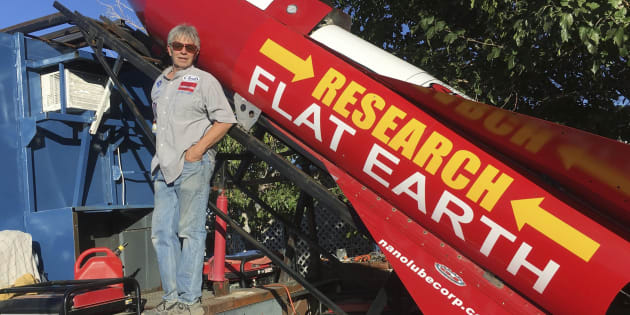 "In this Nov. 15, 2017 photograph, daredevil/limousine driver ""Mad"" Mike Hughes is shown with his steam-powered rocket constructed out of salvage parts on a five-acre property that he leases in Apple Valley, Calif."