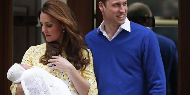 Prince William and his wife Catherine, Duchess of Cambridge, appear with their baby daughter outside the Lindo Wing of St Mary's Hospital, in London, May 2, 2015. (REUTERS/Suzanne Plunkett)