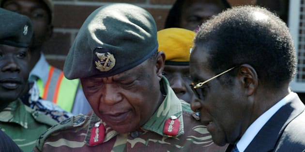 President Robert Mugabe talks to General Constantino Chiwenga in Harare, Zimbabwe, July 4, 2008.