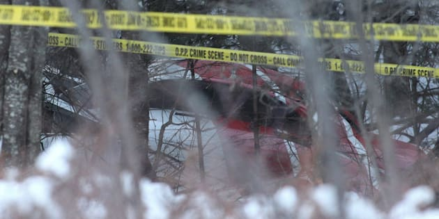 A Hydro One helicopter can be seen at the crash site near Tweed, Ont., on Dec. 14, 2017.