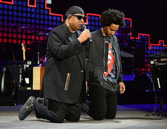 Stevie Wonder takes a knee at Global Citizen Fest