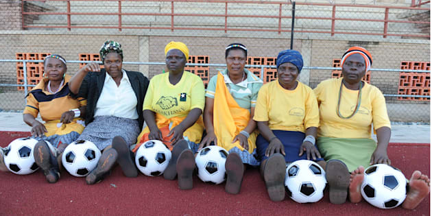South African grandmothers pose with footballs in the Nkowankowa township on November 24 2009, in Tzaneen.