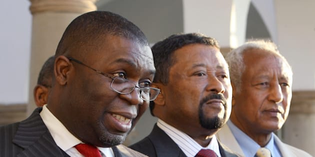Sydney Mufamadi (L) – then SA's Minister of Safety and Security – addresses the media next to African Union Commission chairman Jean Ping (C) and United Nations' special representative to Zimbabwe Haile Menkerios (R) in Pretoria on July 18, 2008.