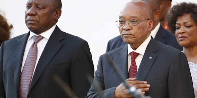 South Africa's then-Deputy President Cyril Ramaphosa and then-President Jacob Zuma stand before the state of the nation address at the opening of Parliament in Cape Town, February 11, 2016.