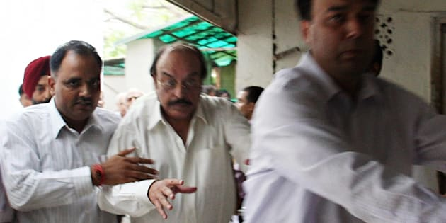 File photo of businessman Gopal Ansal (C) being escorted to the prison.
