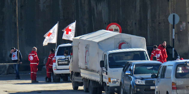 Staff from the International Red Cross and from the Syrian Red Crescent are seen in embattled city of Aleppo as efforts were underway to evacuate rebel fighters and their families from rebel-held areas on December 15, 2016.   Russia, Syrian military sources and rebel officials confirmed that a new agreement had been reached after a first evacuation plan collapsed the day before amid fresh fighting. Syrian state television reported that some 4,000 rebels and their families were to be evacuated.    / AFP / STRINGER        (Photo credit should read STRINGER/AFP/Getty Images)