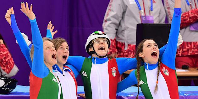 Italy's skaters celebrate winning the silver medal in the women's 3,000m relay short track speed skating A final event during the Pyeongchang 2018 Winter Olympic Games, at the Gangneung Ice Arena in Gangneung on February 20, 2018. / AFP PHOTO / Roberto SCHMIDT        (Photo credit should read ROBERTO SCHMIDT/AFP/Getty Images)