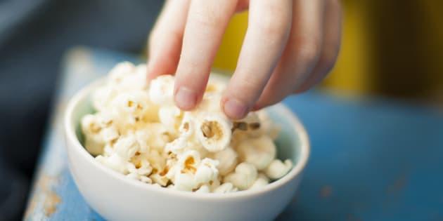 Hand reaching popcorn