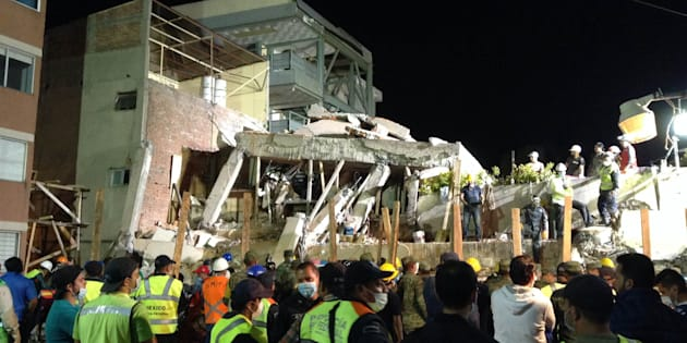 Mexican rescue teams look for people trapped in the rubble at the Enrique Rebsamen elementary school in Mexico City.