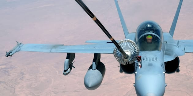 FILE PHOTO: A U.S. Marine Corps F-18 Super Hornet receives fuel from a 908th Expeditionary Air Refueling Squadron KC-10 Extender May 31, 2017, over an undisclosed location in southwest Asia.   U.S. Air Force/Senior Airman Preston Webb/Handout/File Photo via REUTERS  ATTENTION EDITORS - THIS IMAGE HAS BEEN SUPPLIED BY A THIRD PARTY.