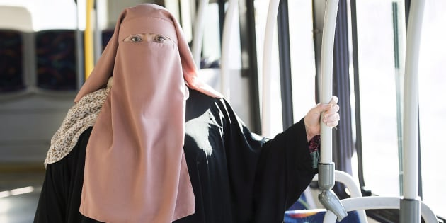 Warda Naili posing on a city bus in Montreal on October 21, 2017. She is worried about what will happen in the wake of the Quebec government's religious neutrality bill.