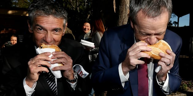 Opposition Leader Bill Shorten and ALP candidate Angelo Tsirekas get their democracy sausage on.