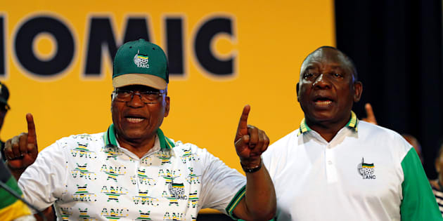 State President Jacob Zuma sings next to president of the ANC Cyril Ramaphosa during the ANC's 54th national conference at the Nasrec Expo Centre in Johannesburg.