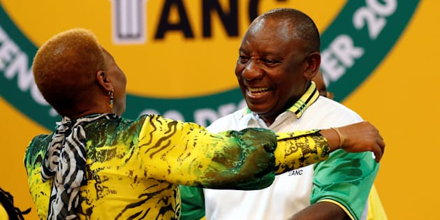 Deputy president of South Africa Cyril Ramaphosa greets an ANC member during the 54th National Conference of the ruling African National Congress (ANC) at the Nasrec Expo Centre in Johannesburg, South Africa December 18, 2017. REUTERS/Siphiwe Sibeko
