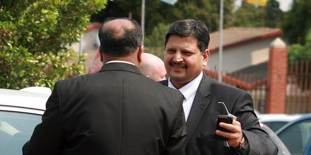 Atul Gupta (R) attends Randburg Magistrate's court on September 27, 2010 in Johannesburg.