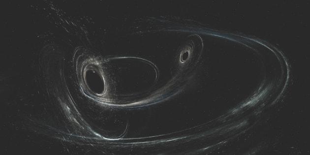 photo d'illustration montrant la fusion de deux trous noirs.