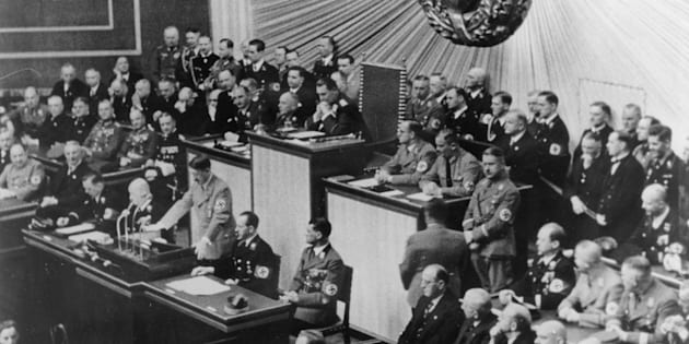 Hitler addresses the Reichstag in Berlin in 1938. Anton Reinthaller is in the first row, fifth from left,according to a caption provided by Getty.