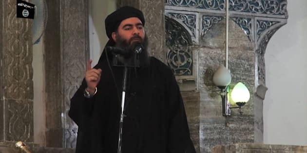 This July 5, 2014 photo shows an image grab taken from a propaganda video released by al-Furqan Media allegedly showing the leader of the Islamic State (IS) jihadist group, Abu Bakr al-Baghdadi, aka Caliph Ibrahim, adressing Muslim worshippers at a mosque in the militant-held northern Iraqi city of Mosul.