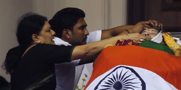 Sasikala Natarajan with the late J Jayalithaa's body. (AP Photo/Aijaz Rahi)