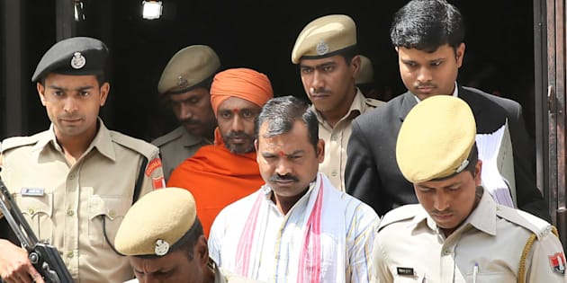 JAIPUR, INDIA - MARCH 16: The accused Devendra (Center) and Bhavesh Patel, convicted in the ajmer blast case.
