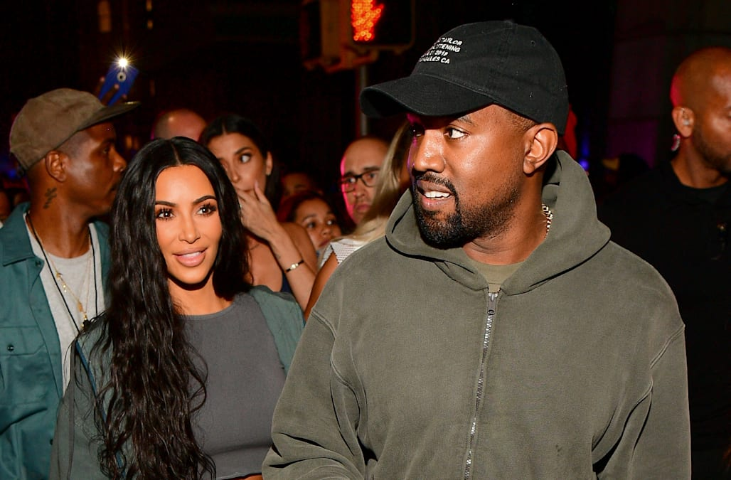 Kanye West and Kim Kardashian are not leaving California - AOL